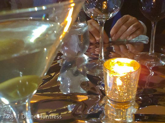 sparkling table with mylar martini and wine glasses with candle