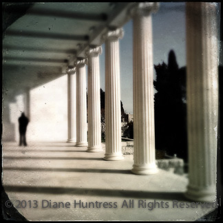 Classical columns and figure in light and shadow