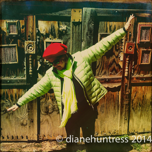 photographer in lime green and red beret